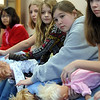 Bailey Estes, 12, second right, with the class learn to remove a blockage from a baby using dolls during the American Red Cross babysitter class at the Broomfield Community Center on Saturday.<br /> <br /> January 09, 2010<br /> Staff photo/David R. Jennings