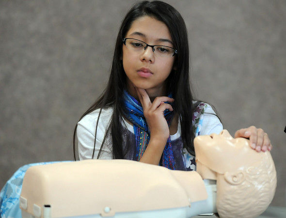Olivia Cornejo, 11, feels her pulse while learning rescue breathing during the American Red Cross babysitter class at the Broomfield Community Center on Saturday.<br /> <br /> January 09, 2010<br /> Staff photo/David R. Jennings