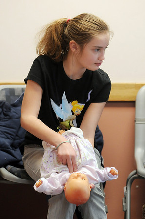 Avery Bohn, 11, practices unblocking a baby's airway  on dolls during the American Red Cross babysitter class at the Broomfield Community Center on Saturday.<br /> <br /> January 09, 2010<br /> Staff photo/David R. Jennings