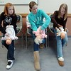 Tayler Reece, 11, left, Kaylee Esplin, 11, and Annamarie Bodine, 11, practice how to unblock a baby's airway on dolls during the American Red Cross babysitter class at the Broomfield Community Center on Saturday.<br /> <br /> January 09, 2010<br /> Staff photo/David R. Jennings