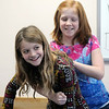 Tayler Reece, 11, right, practices unblocking an airway on classmate Kayla Schlieper, 11, during the American Red Cross babysitter class at the Broomfield Community Center on Saturday.<br /> <br /> <br /> January 09, 2010<br /> Staff photo/David R. Jennings