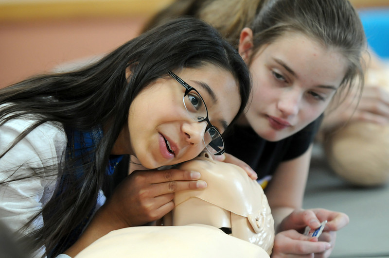 Olivia Cornejo, 11, left, listens for breath on a child dummy while Avery Bohn, 11, watches during the American Red Cross babysitter class at the Broomfield Community Center on Saturday.<br /> <br /> January 09, 2010<br /> Staff photo/David R. Jennings