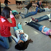 Students in the American Red Cross babysitter class practice how to put a patient into the recovery position during the class at the Broomfield Community Center on Saturday.<br /> <br /> January 09, 2010<br /> Staff photo/David R. Jennings
