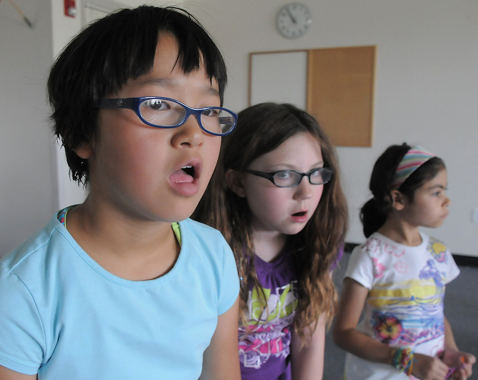 Lily McKeralt-Gould, 9, left, Lianna Duran, 9, and Gabby Lovatto, 6, play the monkeys who just forgot what they were just doing during rehearsal for  BackStory Theater Academy's production of the Jungle Book at Aspen Creek K-8 on Friday.<br /> <br /> July 8, 2011<br /> staff photo/ David R. Jennings