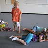 Mowgli ( Bode Hogan, 7, ) watches the monkeys fall asleep during rehearsal for  BackStory Theater Academy's production of the Jungle Book at Aspen Creek K-8 on Friday.<br /> <br /> July 8, 2011<br /> staff photo/ David R. Jennings