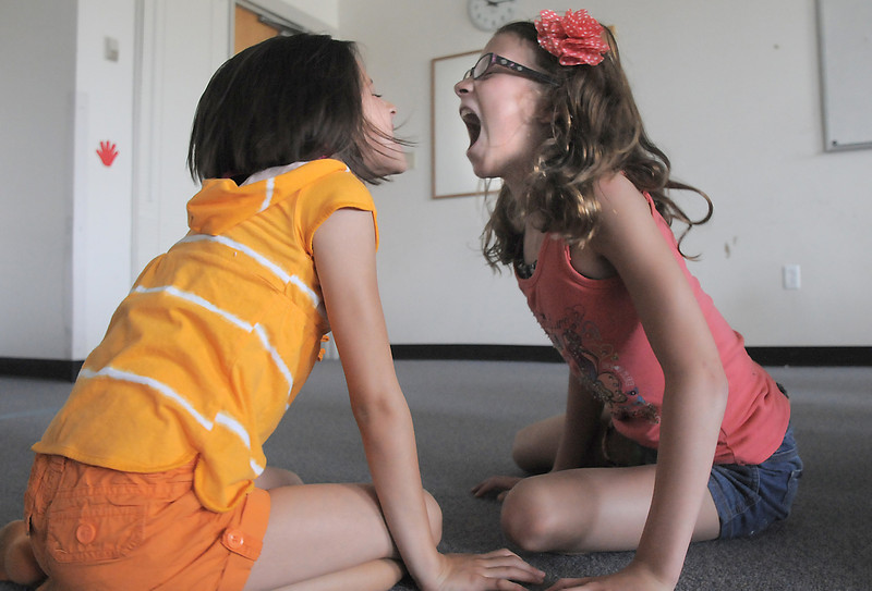 Alexandra Gomez, 8, left, and Christina Perez, 9, practice being jackals during rehearsal for  BackStory Theater Academy's production of the Jungle Book at Aspen Creek K-8 on Friday.<br /> <br /> July 8, 2011<br /> staff photo/ David R. Jennings