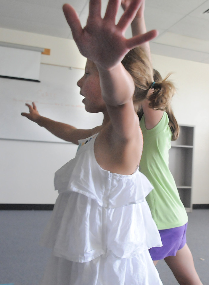 Avery Schmidt, 7, and Sarah Carleo, 8, play birds during rehearsal for  BackStory Theater Academy's production of the Jungle Book at Aspen Creek K-8 on Friday.<br /> <br /> July 8, 2011<br /> staff photo/ David R. Jennings
