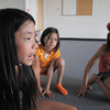 Jade Martin, 11, left, playing Shere Khan, orders the jackals, Alexandra Gomez, 8, and Christina Perez, 9, to search for Mowgli during rehearsal for  BackStory Theater Academy's production of the Jungle Book at Aspen Creek K-8 on Friday.<br /> <br /> July 8, 2011<br /> staff photo/ David R. Jennings