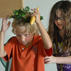 Bobe Hogan, 7, ( Mowgli) receives a crown as king of the monkeys by Kianna Duran, 9, during rehearsal for  BackStory Theater Academy's production of the Jungle Book at Aspen Creek K-8 on Friday.<br /> <br /> July 8, 2011<br /> staff photo/ David R. Jennings