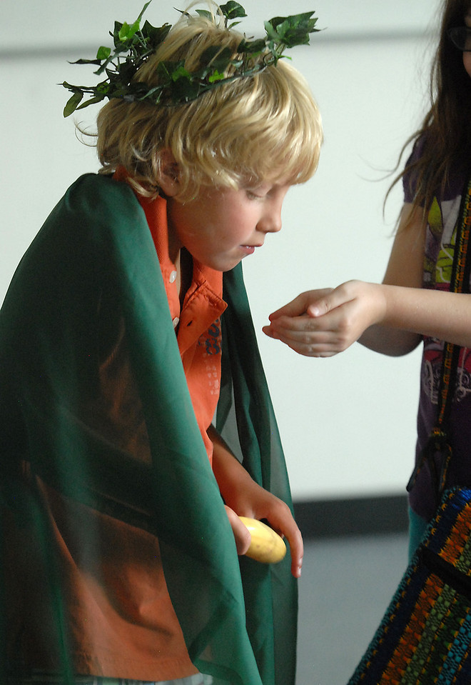 Bode Hogan, 7, (Mowgli) receives a gift after being crowned the king of the monkeys during rehearsal for  BackStory Theater Academy's production of the Jungle Book at Aspen Creek K-8 on Friday.<br /> <br /> July 8, 2011<br /> staff photo/ David R. Jennings