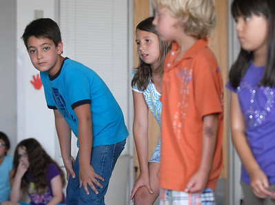 Jack Stewart, 10, left, playing Baloo and Emily Jaramillo, 10, wait to say their lines during rehearsal for  BackStory Theater Academy's production of the Jungle Book at Aspen Creek K-8 on Friday.  July 8, 2011 staff photo/ David R. Jennings