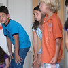 Jack Stewart, 10, left, playing Baloo and Emily Jaramillo, 10, wait to say their lines during rehearsal for  BackStory Theater Academy's production of the Jungle Book at Aspen Creek K-8 on Friday.<br /> <br /> July 8, 2011<br /> staff photo/ David R. Jennings