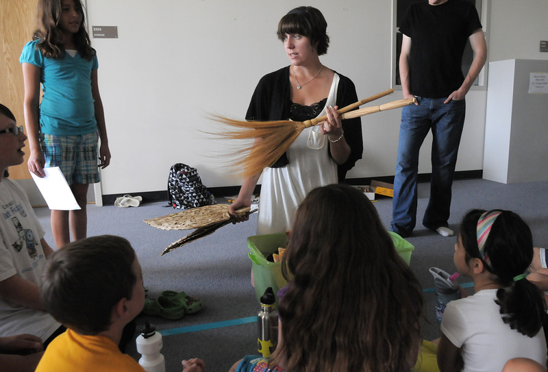 Director Emily Andrews explains the props for the play during rehearsal for  BackStory Theater Academy's production of the Jungle Book at Aspen Creek K-8 on Friday.<br /> <br /> July 8, 2011<br /> staff photo/ David R. Jennings