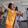 Alexandra Gomez, 8, plays at being an animal during the warm-up before the rehearsal for  BackStory Theater Academy's production of the Jungle Book at Aspen Creek K-8 on Friday.<br /> <br /> July 8, 2011<br /> staff photo/ David R. Jennings