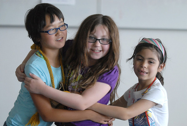 Lily McKeralt-Gould, 9, left, Kianna Duran, 9, and Gabby Lovatto, 6, play the monkeys during rehearsal for  BackStory Theater Academy's production of the Jungle Book at Aspen Creek K-8 on Friday.<br /> <br /> July 8, 2011<br /> staff photo/ David R. Jennings