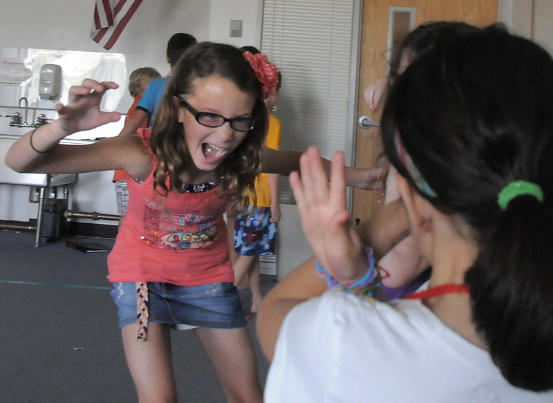Christina Perez, 9, plays Nagaina the king cobra tries to scare other animals during rehearsal for  BackStory Theater Academy's production of the Jungle Book at Aspen Creek K-8 on Friday.<br /> <br /> July 8, 2011<br /> staff photo/ David R. Jennings