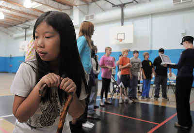 Janelle Campbell, 10, practices using a cane while Anna Wilcox works with another group of actors during a rehearsal of the BackStory Theatre's Youth Theatre production of Bird Brains at the Broomfield Community Center on Saturday. October 29, 2011 staff photo/ David R. Jennings