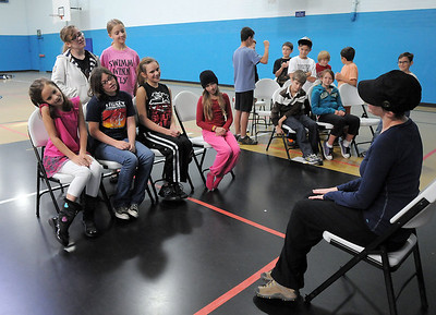 Director/producer Anna Wilcox, right, works with a group on choreography for a musical number during a rehearsal of the BackStory Theatre's Youth Theatre production of Bird Brains at the Broomfield Community Center on Saturday. October 29, 2011 staff photo/ David R. Jennings