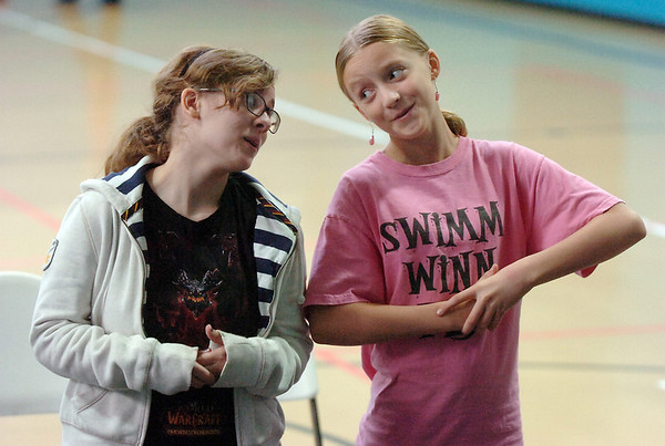 Emily Alexander, 15, left, ( Alice ) and Emma Anderson, 12, ( Marie ) sing their duet parts during a rehearsal of the BackStory Theatre's Youth Theatre production of Bird Brains at the Broomfield Community Center on Saturday.<br /> October 29, 2011<br /> staff photo/ David R. Jennings