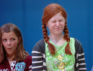 Katie Blair, 12, left, and Kendall Ritger, 11, make faces for the warm-up during a rehearsal of the BackStory Theatre's Youth Theatre production of Bird Brains at the Broomfield Community Center on Saturday. October 29, 2011 staff photo/ David R. Jennings