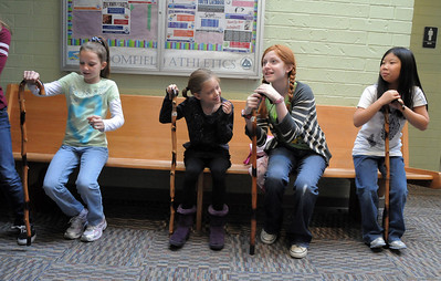 Brooklynn Kirkpatrick, left, Grace Nordgren, 10, Kendall Ritger, 11, and Janelle Campbell learn to use a cane for their parts during a rehearsal of the BackStory Theatre's Youth Theatre production of Bird Brains at the Broomfield Community Center on Saturday. October 29, 2011 staff photo/ David R. Jennings