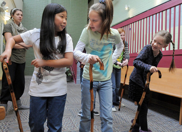 Actors Janelle Campbell, left, Brooklynn Kirkpatrick, and Grace Nordgren practice using their canes during a rehearsal of the BackStory Theatre's Youth Theatre production of Bird Brains at the Broomfield Community Center on Saturday.<br /> October 29, 2011<br /> staff photo/ David R. Jennings