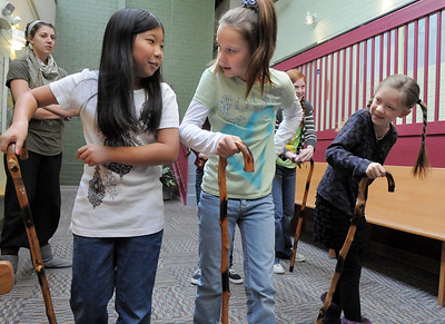 Actors Janelle Campbell, left, Brooklynn Kirkpatrick, and Grace Nordgren practice using their canes during a rehearsal of the BackStory Theatre's Youth Theatre production of Bird Brains at the Broomfield Community Center on Saturday. October 29, 2011 staff photo/ David R. Jennings