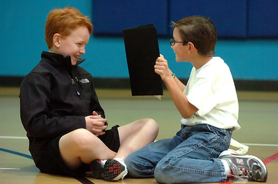 L.J. Shearer, 9, left, works on his lines with the help of Peter Cabrera, 10, during a rehearsal of the BackStory Theatre's Youth Theatre production of Bird Brains at the Broomfield Community Center on Saturday. October 29, 2011 staff photo/ David R. Jennings