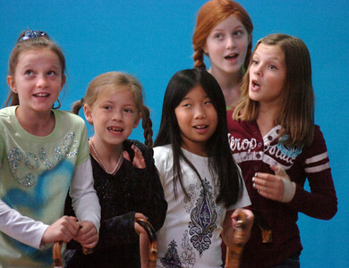 Actors Brooklynn Kirkpatrick, 9, left, Grace Nordgren, 10, Janelle Campbell, 10, Kendall Ritger, 11, and  Katie Blair, 12, playing the elderly women sing a number during a rehearsal of the BackStory Theatre's Youth Theatre production of Bird Brains at the Broomfield Community Center on Saturday. October 29, 2011 staff photo/ David R. Jennings