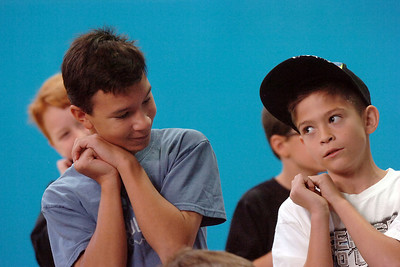 Antonio Cabrera, 12, left, and Ben Rodgriquez, 10, practice gestures for a song during a rehearsal of the BackStory Theatre's Youth Theatre production of Bird Brains at the Broomfield Community Center on Saturday. October 29, 2011 staff photo/ David R. Jennings