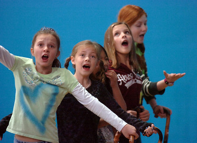 Actors Brooklynn Kirkpatrick, 9, left, Grace Nordgren, 10, Janelle Campbell, 10, Katie Blair, 12, and Kendall Ritger, 11, playing the elderly women sing a number during a rehearsal of the BackStory Theatre's Youth Theatre production of Bird Brains at the Broomfield Community Center on Saturday. October 29, 2011 staff photo/ David R. Jennings