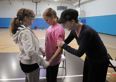 Anna Wilcox, right, helps fine turn the choreography for Emily Alexander, left, and Emma Anderson during a rehearsal of the BackStory Theatre's Youth Theatre production of Bird Brains at the Broomfield Community Center on Saturday. October 29, 2011 staff photo/ David R. Jennings