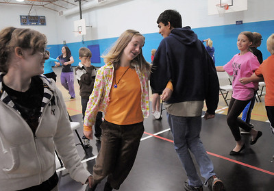 Eleanor Davis, 14, dances with Jeremy Sunderraj, 15, while Emily Alexander, 15, waits her turn during a rehearsal of the BackStory Theatre's Youth Theatre production of Bird Brains at the Broomfield Community Center on Saturday. October 29, 2011 staff photo/ David R. Jennings