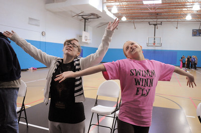 Emily Alexander, 15, left, ( Alice ) and Emma Anderson, 12, ( Marie ) sing their duet parts during a rehearsal of the BackStory Theatre's Youth Theatre production of Bird Brains at the Broomfield Community Center on Saturday. October 29, 2011 staff photo/ David R. Jennings