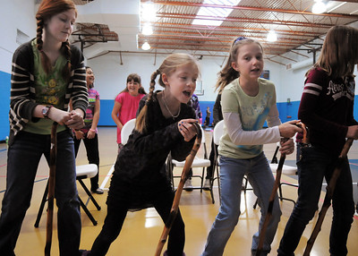 Kendall Ritger, 11, left, Grace Nordgren, 10, Brooklynn Kirkpartrick, 9, and Katie Blair, 12, playing elderly women sing during a musical number at rehearsal of the BackStory Theatre's Youth Theatre production of Bird Brains at the Broomfield Community Center on Saturday. October 29, 2011 staff photo/ David R. Jennings