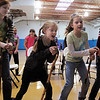 Kendall Ritger, 11, left, Grace Nordgren, 10, Brooklynn Kirkpartrick, 9, and Katie Blair, 12, playing elderly women sing during a musical number at rehearsal of the BackStory Theatre's Youth Theatre production of Bird Brains at the Broomfield Community Center on Saturday.<br /> October 29, 2011<br /> staff photo/ David R. Jennings