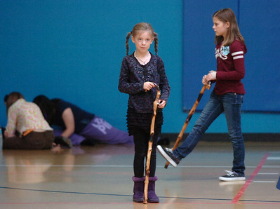 Grace Nordgren, 10, left, and Katie blair, 12, practice using their canes during a rehearsal of the BackStory Theatre's Youth Theatre production of Bird Brains at the Broomfield Community Center on Saturday. October 29, 2011 staff photo/ David R. Jennings