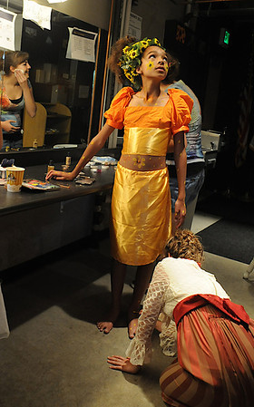 Lauren Smith, 13, looks up while Maggie Amire, 16, applies makeup to Lauren's feet as the Summer Youth Players prepare backstage for Saturday's matinee performance of A Midsummer Night's Dream at the Audi.<br /> August 1, 2009<br /> staff photo/David Jennings