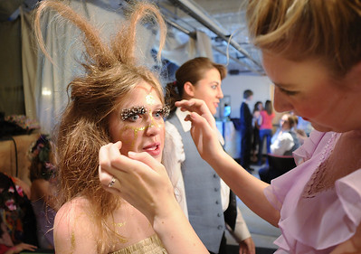 Michelle Green , 14, left, playing Moth  a fairy, opens her eyes after Tori Baird, 16, applied the large eyelashes  as  the Summer Youth Players prepare backstage for Saturday's matinee performance of A Midsummer Night's Dream at the Audi. August 1, 2009 staff photo/David Jennings