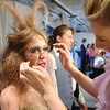 Michelle Green , 14, left, playing Moth  a fairy, opens her eyes after Tori Baird, 16, applied the large eyelashes  as  the Summer Youth Players prepare backstage for Saturday's matinee performance of A Midsummer Night's Dream at the Audi.<br /> August 1, 2009<br /> staff photo/David Jennings