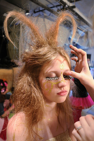 Michelle Green , 14, has large eyelashes applied for her part as Moth a fairy, as  the Summer Youth Players prepare backstage for Saturday's matinee performance of A Midsummer Night's Dream at the Audi.<br /> August 1, 2009<br /> staff photo/David Jennings