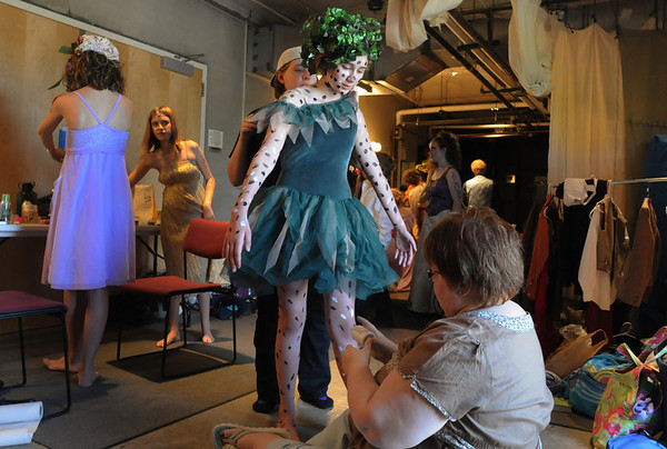 Kayle Lingo, 12, center, stands still while the makeup crew puts dots on her for her part as a fairy in the Summer Youth Players  performance of A Midsummer Night's Dream at the Audi on Saturday.<br /> August 1, 2009<br /> staff photo/David Jennings