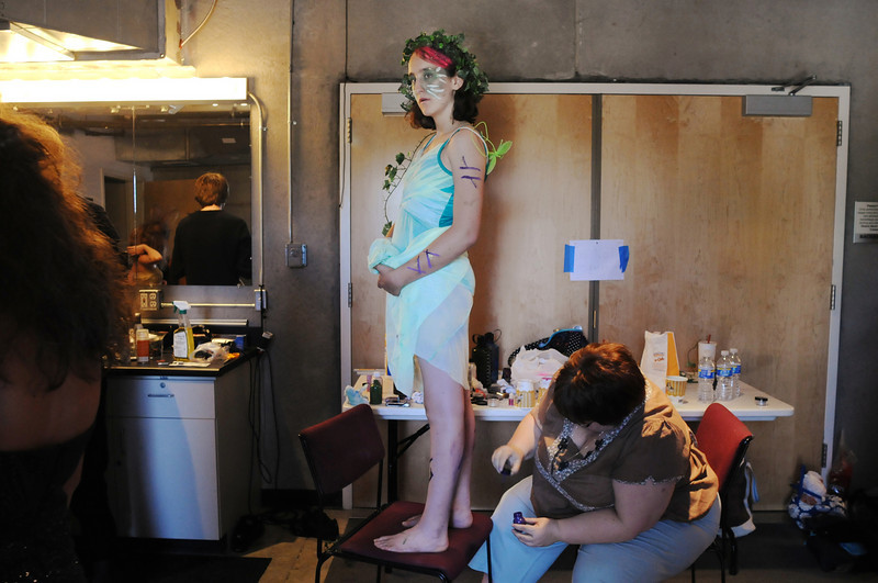 Laurel Hale, 13, stands on a chair while makeup in applied to her legs as the Summer Youth Players prepare backstage for Saturday's matinee performance of A Midsummer Night's Dream at the Audi.<br /> August 1, 2009<br /> staff photo/David Jennings