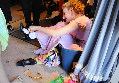 Tori Baird, 16, sits in a box while putting on her shoes before the Summer Youth Players performance of A Midsummer Night's Dream at the Audi Saturday afternoon. August 1, 2009 staff photo/David Jennings