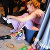 Tori Baird, 16, sits in a box while putting on her shoes before the Summer Youth Players performance of A Midsummer Night's Dream at the Audi Saturday afternoon.<br /> August 1, 2009<br /> staff photo/David Jennings