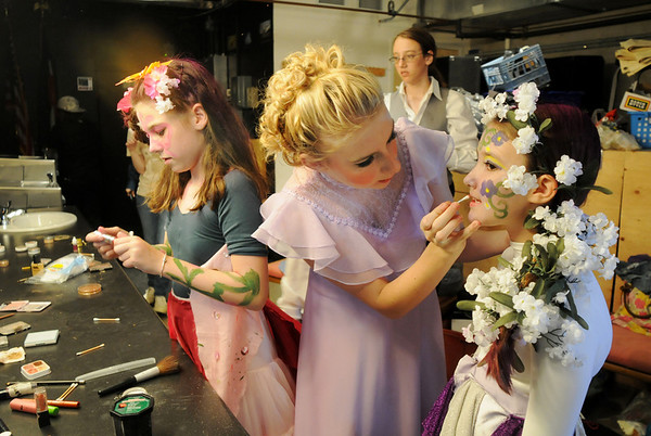 Emma Tocci, 11, left, puts on her makeup while Tori Baird, 16, helps Emma Tocci, 11, while preparing backstage for the Summer Youth Players Saturday matinee performance of A Midsummer Night's Dream at the Audi.<br /> August 1, 2009<br /> staff photo/David Jennings