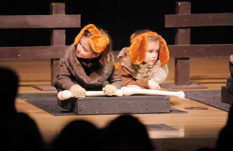 Dog one and two Dorothy Bennett, 8, left, and Cadence Nichols, 5, chew on their bones during the Backstory Theatre Academy's Make Believe and Beyond class production of The Bremen Town Musicians at the Audi on Tuesday.<br /> <br /> March 1, 2011<br /> staff photo/David R. Jennings