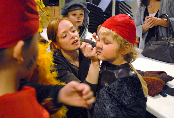 Tyler Fischer, 5, gets his robber makeup on by assistant director Abbie Griffith for the Backstory Theatre Academy's Make Believe and Beyond class production of The Bremen Town Musicians at the Audi on Tuesday.<br /> <br /> March 1, 2011<br /> staff photo/David R. Jennings