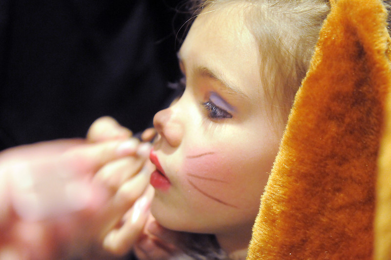 Dorothy Bennett, 8, gets her dog nose on backstage before the Backstory Theatre Academy's Make Believe and Beyond class production of The Bremen Town Musicians at the Audi on Tuesday.<br /> <br /> March 1, 2011<br /> staff photo/David R. Jennings