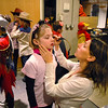 Jeanne Gregory puts makeup on her daughter Lily, 5, backstage before the Backstory Theatre Academy's Make Believe and Beyond class production of The Bremen Town Musicians at the Audi on Tuesday.<br /> <br /> March 1, 2011<br /> staff photo/David R. Jennings